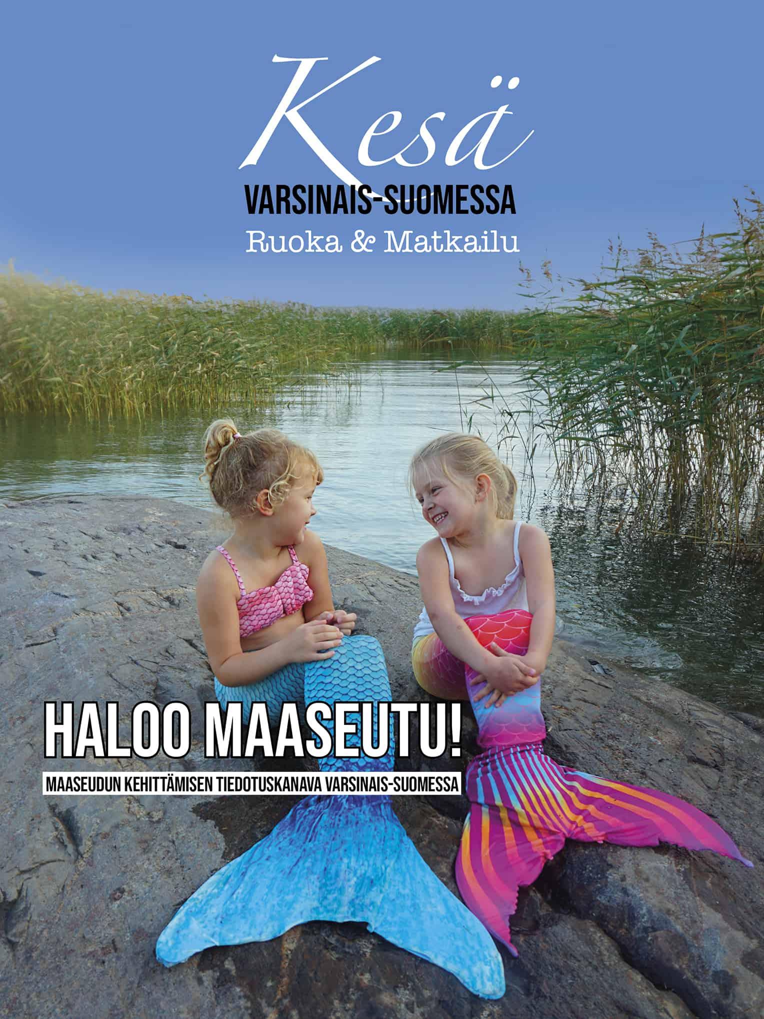 Lehden kansikuvassa kaksi pientä tyttöä merenneitoina istumassa kivellä Varsinais-Suomen saaristossa.