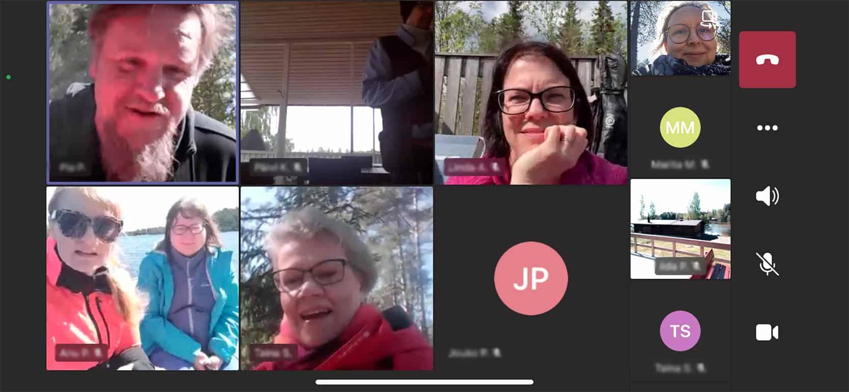 Näyttökuva Teams-kokouksesta, jossa näkyy monet kasvot.